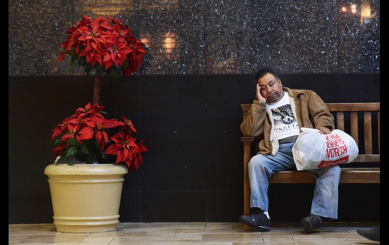 A man takes a rest from shopping at the Viewmont Mall in Dickson City - A man takes a rest from Black Friday shopping at the Viewmont Mall in Dickson City, Pa., on Friday, Nov. 24, 2017.  ( Butch Comegys / The Times & Tribune via AP)  MANDATORY CREDIT - MANDATORY CREDIT