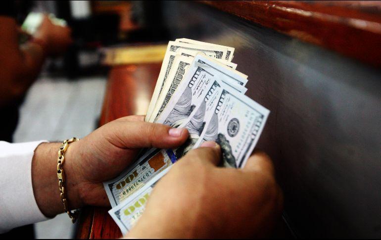 Para este día la institución financiera prevé que el tipo de cambio se cotice entre 19.05 y 19.25 pesos por dólar. EL INFORMADOR  ARCHIVO