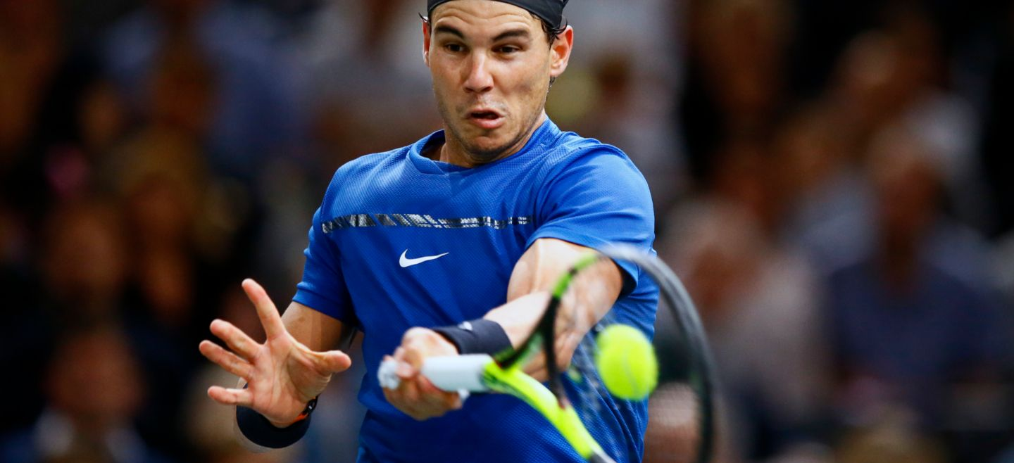 Rafael Nadal of Spain returns the ball to Hyeon Chung of South Korea - Rafael Nadal of Spain returns the ball to Hyeon Chung of South Korea during the Paris Masters tennis tournament at the Bercy Arena in Paris, France, Wednesday, Nov. 1, 2017. (AP Photo/Francois Mori) France Tennis Paris Masters