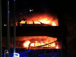 Vehicles burn during a blaze at a multi-storey car park at the Echo A - Vehicles burn during a blaze at a multi-storey car park at the Echo Arena on the waterfront in Liverpool, England Sunday, Dec. 31, 2017. An evening session of the Liverpool International Horse Show taking place in the Echo Arena was cancelled after horses were evacuated to safety. No one is known to have been injured in the fire. (Peter Byrne/PA via AP) Britain Fire - UNITED KINGDOM OUT  NO SALES  NO ARCHIVE  PHOTOGRAPH CANNOT BE STORED OR USED FOR MORE THAN 14 DAYS AFTER THE DAY OF TRANSMISSION