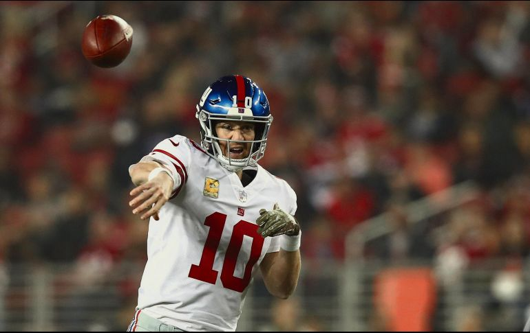 Eli Manning tuvo una de sus mejores actuaciones del año al lanzar tres pases de anotación. afp  E. Shaw