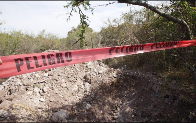 Hallan al menos 69 cuerpos en varias fosas comunes en México