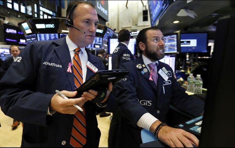 El promedio industrial Dow Jones ganó ocho unidades, menos del 0.1%, y se ubicó en 26 mil 727 puntos. AP/ARCHIVO