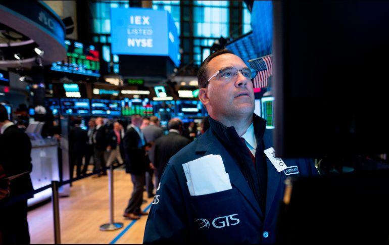 El Dow Jones cayó 179 puntos, 0.7 por ciento, a 26 mil 548 puntos. AFP/J. Eisele