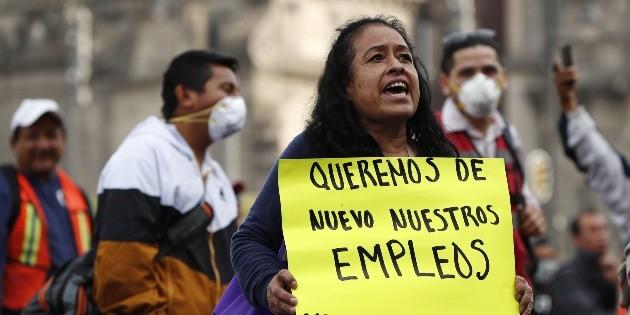 Protestan comerciantes del Metro y albañiles en Palacio Nacional