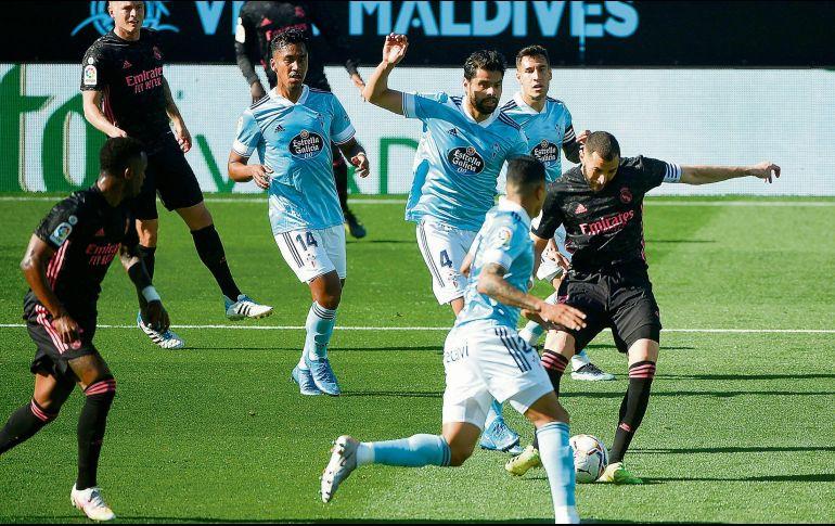 ENCENDIDO. Karim Benzema suma cinco juegos seguidos con gol. Ayer marcó un doblete. AFP