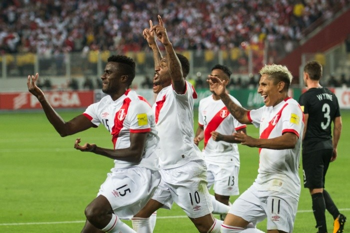 Peru's Christian Ramos (L) celebrates with teammates after scoring ag - Peru's Christian Ramos (L) celebrates with teammates after scoring against New Zealand during their 2018 World Cup qualifying play-off second leg football match, in Lima, Peru, on November 15, 2017. / AFP / Ernesto BENAVIDES FBL-WC-2018-PER-NZL