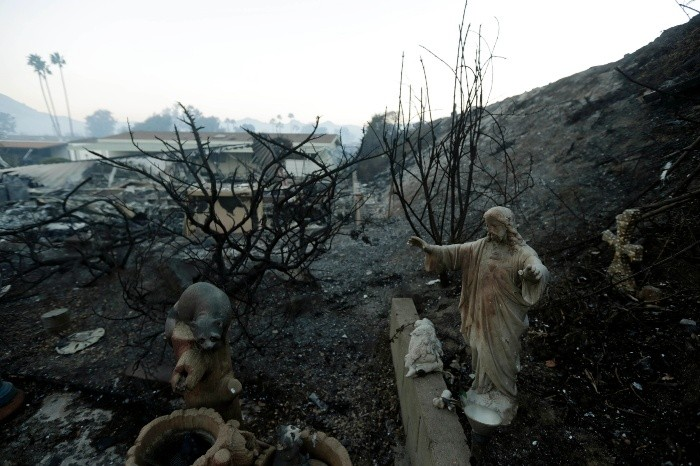 A statue sits among destroyed homes in the Rancho Monserate Country C - A statue sits among destroyed homes in the Rancho Monserate Country Club community Friday, Dec. 8, 2017, in Fallbrook, Calif. The wind-swept blazes have forced tens of thousands of evacuations and destroyed dozens of homes in Southern California. (AP Photo/Gregory Bull) California Wildfires